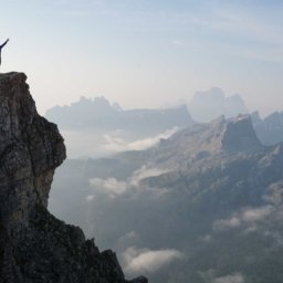 Business Sustainability | picture of man on the top of mountain